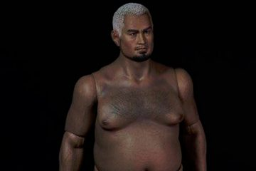 Oh. My. God. Someone please tell me what is happening with this Mark Hunt doll.